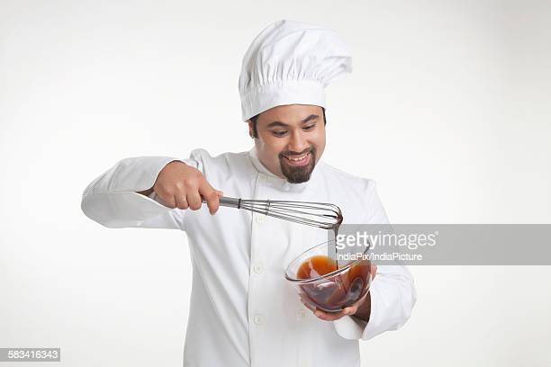 Chef mixing chocolate in a bowl