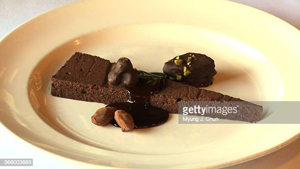 Chef Nancy Silverton shows how to make a chocolate cake adorned with homemade chocolate confections –– almonds dipped in caramelized sugar and...