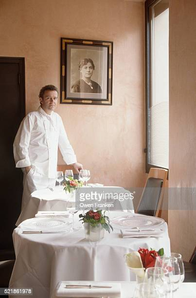 Chef Next to Picture of His Grandmother