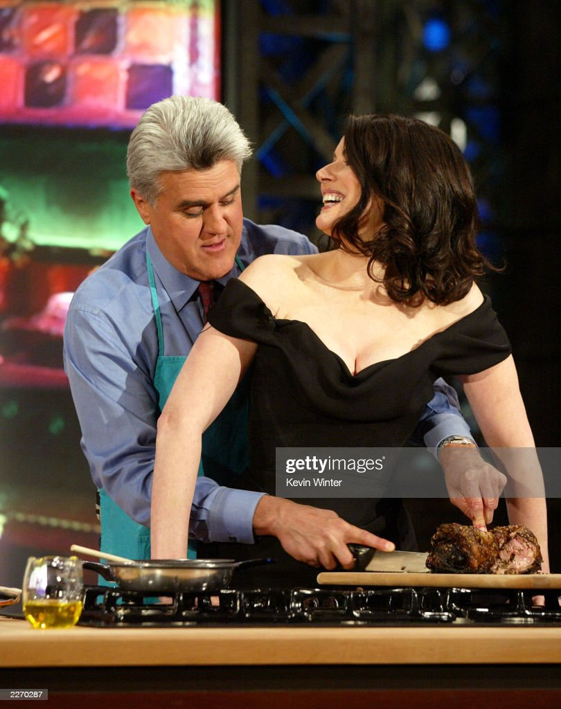 Chef Nigella Lawson (R) appears on 'The Tonight Show with <a gi-track='captionPersonalityLinkClicked' href=/galleries/search?phrase=Jay+Leno+-+Television+Host&family=editorial&specificpeople=156431 ng-click='$event.stopPropagation()'>Jay Leno</a>' at the NBC Studios on April 29, 2003 in Burbank, California.