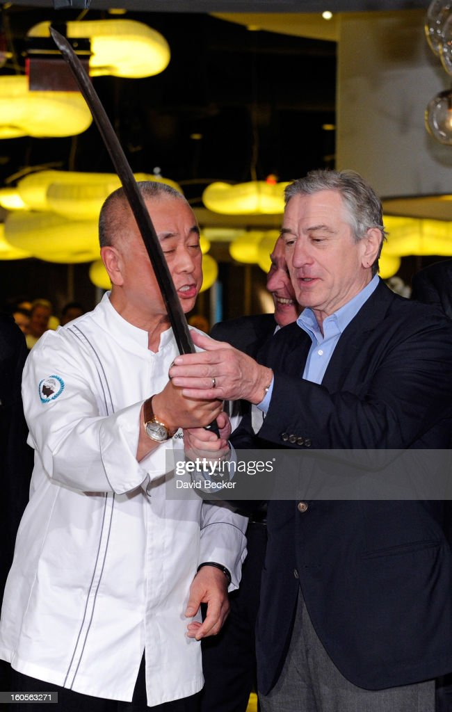 Chef Nobu Matsuhisa (L) and Actor Robert De Niro handle a sword that was used for a ribbon cutting ceremony during a preview for the Nobu Restaurant and Lounge Caesars Palace on February 2, 2013 in Las Vegas, Nevada. The Nobu Hotel Restaurant and Lounge Casears Palace is scheduled to open on February 4.