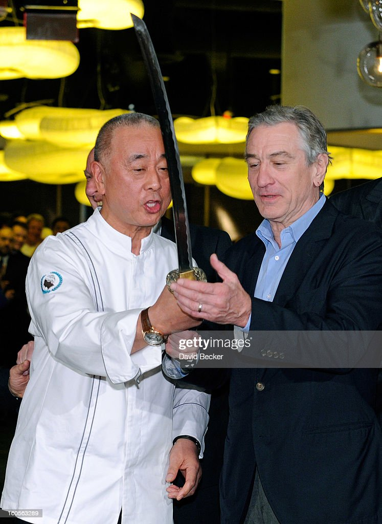 Chef <a gi-track='captionPersonalityLinkClicked' href=/galleries/search?phrase=Nobu+Matsuhisa&family=editorial&specificpeople=4292658 ng-click='$event.stopPropagation()'>Nobu Matsuhisa</a> (L) and Actor Robert De Niro handle a sword that was used for a ribbon cutting ceremony during a preview for the Nobu Restaurant and Lounge Caesars Palace on February 2, 2013 in Las Vegas, Nevada. The Nobu Hotel Restaurant and Lounge Casears Palace is scheduled to open on February 4.