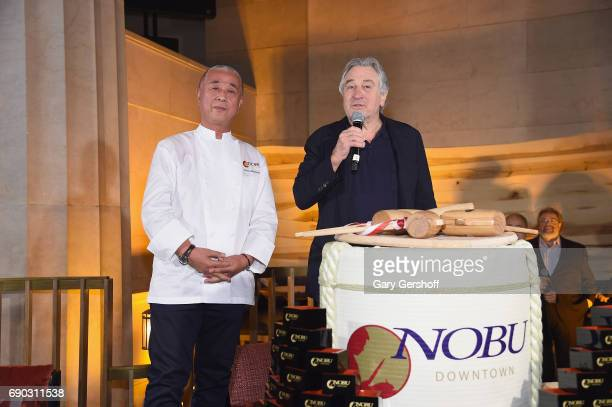 Chef Nobu Matsuhisa and Robert De Niro attend the Nobu Downtown Sake ceremony to celebrate the new Nobu at Nobu Downtown on May 30 2017 in New York...