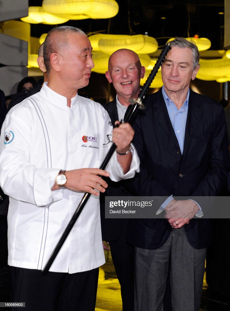 Chef Nobu Matsuhisa, CEO of Nobu Hospitality Trevor Horwell and actor Robert De Niro handle a sword during a ribbon cutting ceremony at a preview for the Nobu Restaurant and Lounge Caesars Palace on February 2, 2013 in Las Vegas, Nevada. The Nobu Hotel Restaurant and Lounge Casears Palace is scheduled to open on February 4.