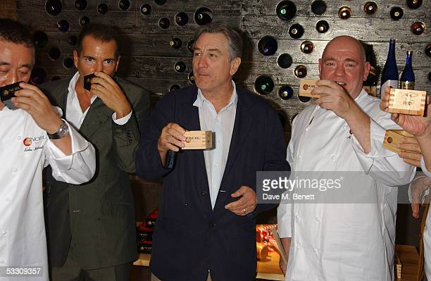 Chef Nobu Matsuhisa Richie Notar actor Robert De Niro and Mark Edwards attend the launch party for London's second Nobu restaurant Nobu Berkeley at...