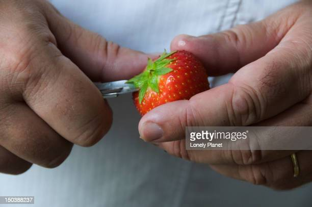 Chef of Les Coulisses du Chef cutting strawberry during cooking course.
