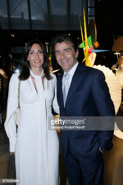 Chef of the Pavillon Ledoyen Yannick Alleno and his wife Laurence pose in front the works of JeanPaul Goude during the 'Societe des Amis du Musee...