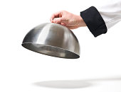 Chef opening cloche lid