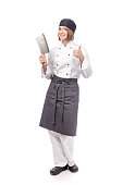 smiling showing thumb up female chef or cook with meat knife isolated on white background. restaurant, dieting and cooking food concept