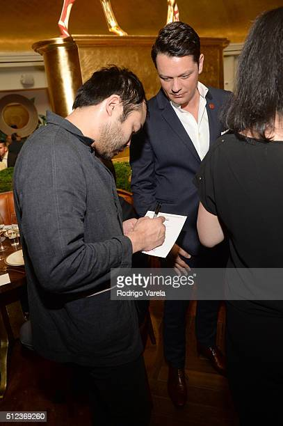 Chef Paul Qui signs an autograph at a Dinner Hosted By Francis Mallmann And Paul Qui during 2016 Food Network Cooking Channel South Beach Wine Food...