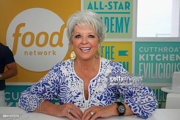 Chef Paula Deen signs books at the KitchenAid Culinary Demonstrations during the 2015 Food Network Cooking Channel South Beach Wine Food Festival...