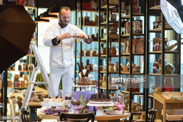 Chef photographing desserts