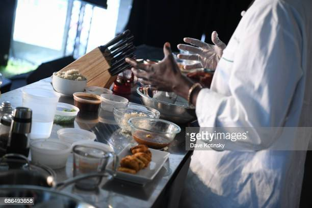 Chef Pierre Thiam does a cooking demo at Harlem EatUp's Third Annual Festival Weekend on May 21 2017 in New York City