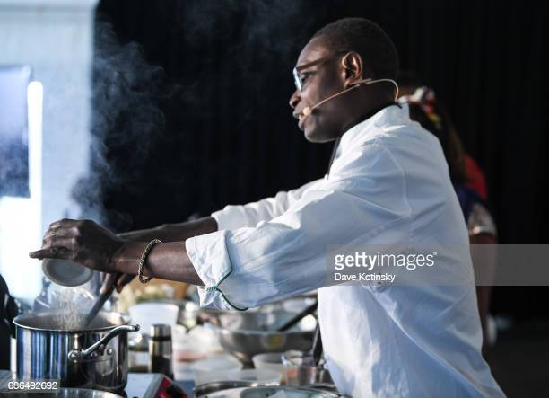 Chef Pierre Thiam dose a cooking demo at Harlem EatUp's Third Annual Festival Weekend on May 21 2017 in New York City