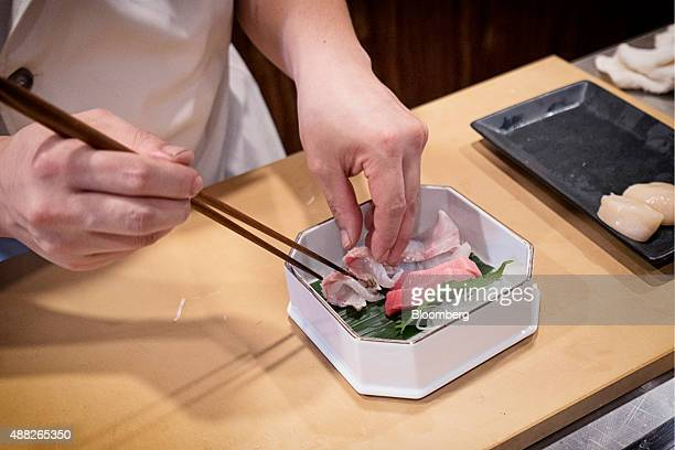 A chef prepares a plate of raw fish at the Kanda Wadatsumi restaurant in Singapore on Wednesday Aug 5 2015 Shipments of seafood from Japan reached...
