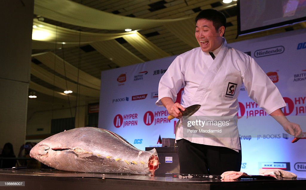 A chef prepares a tuna at The Hyper Japan event at Earls Court on November 23, 2012 in London, England. The show is the UK's biggest Japanese Culture event, with stalls selling clothing and artwork. live music, Japanese food and computer gaming areas are also on show. Many attendees dress up as anime characters or in the lolita fashion widespread in Japan.