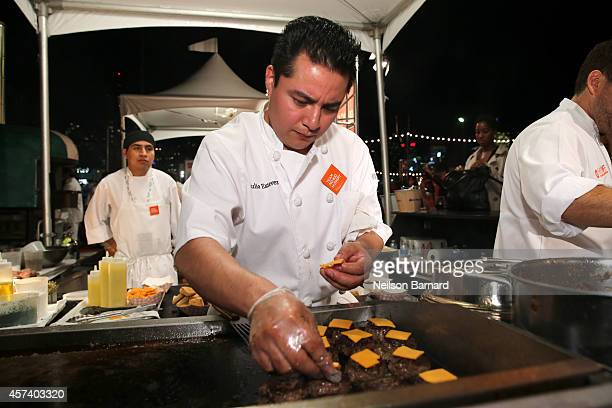 A chef prepares burgers at the Blue Moon Burger Bash presented by Pat LaFrieda Meats hosted by Rachael Ray during the Food Network New York City Wine...