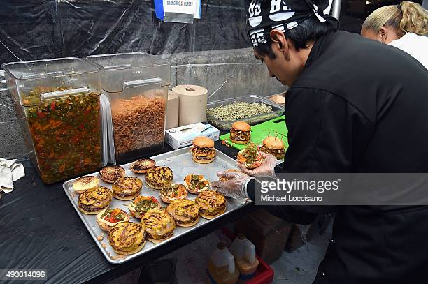 A chef prepares burgers during the Blue Moon Burger Bash presented by Pat LaFrieda Meats hosted by Rachael Ray Food Network Cooking Channel New York...