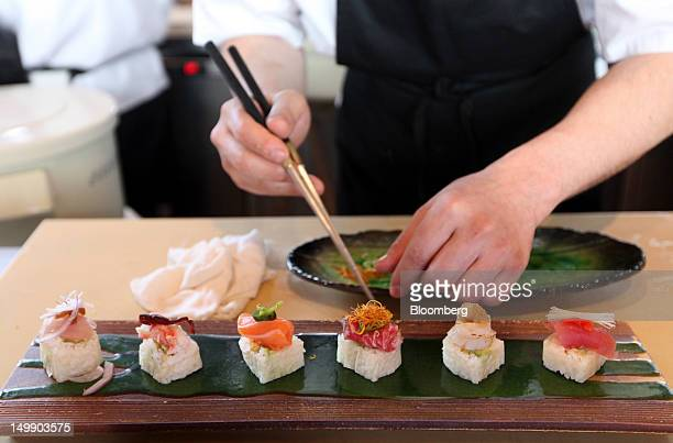 A chef prepares fresh sushi in the kitchen area at the Sushisamba restaurant in London UK on Friday Aug 3 2012 Sushisamba is a barandrestaurant...