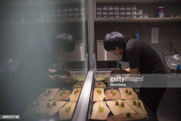 A chef prepares 'goat brain' in the kitchen of Gaggan restaurant in Bangkok Thailand on Friday May 5 2017 After his restaurant's third straight win...