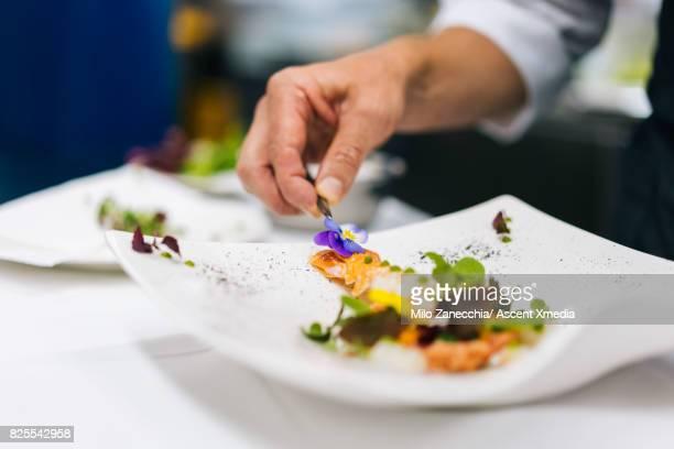 Chef prepares healthy salad