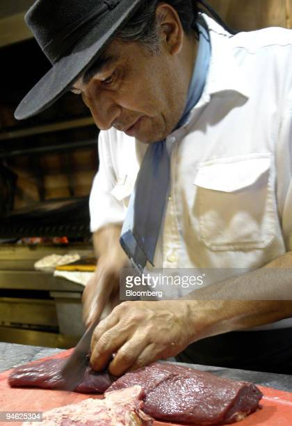 A chef prepares meat at Las Nazarenas in Buenos Aires Argentina on Friday Sept 21 2007 I went looking for great steak in a country where cattle eat...