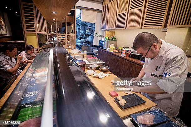 A chef prepares raw fish at the Kanda Wadatsumi restaurant in Singapore on Wednesday Aug 5 2015 Shipments of seafood from Japan reached 293806 metric...