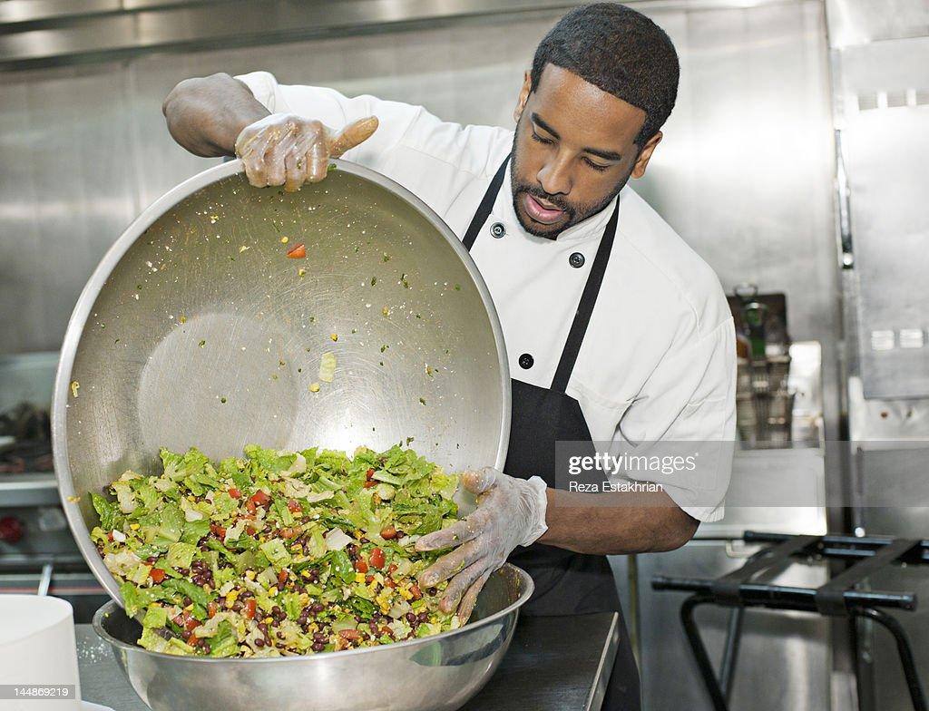 Chef prepares salad : Stock Photo