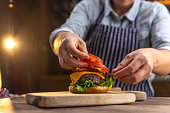 Chef preparing a hamburger