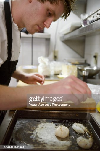 Chef preparing appetizer in kitchen, close-up : Stock Photo