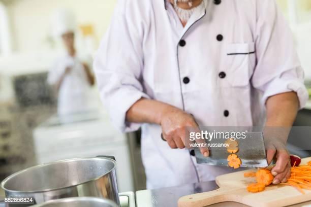 Chef preparing asian food in restaurant's kitchen