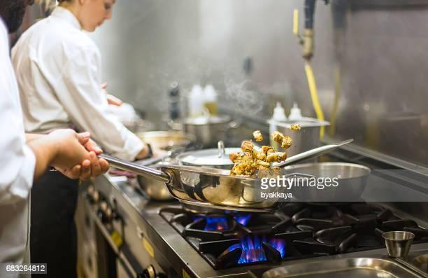 Chef preparing cuisine in hotel kitchen
