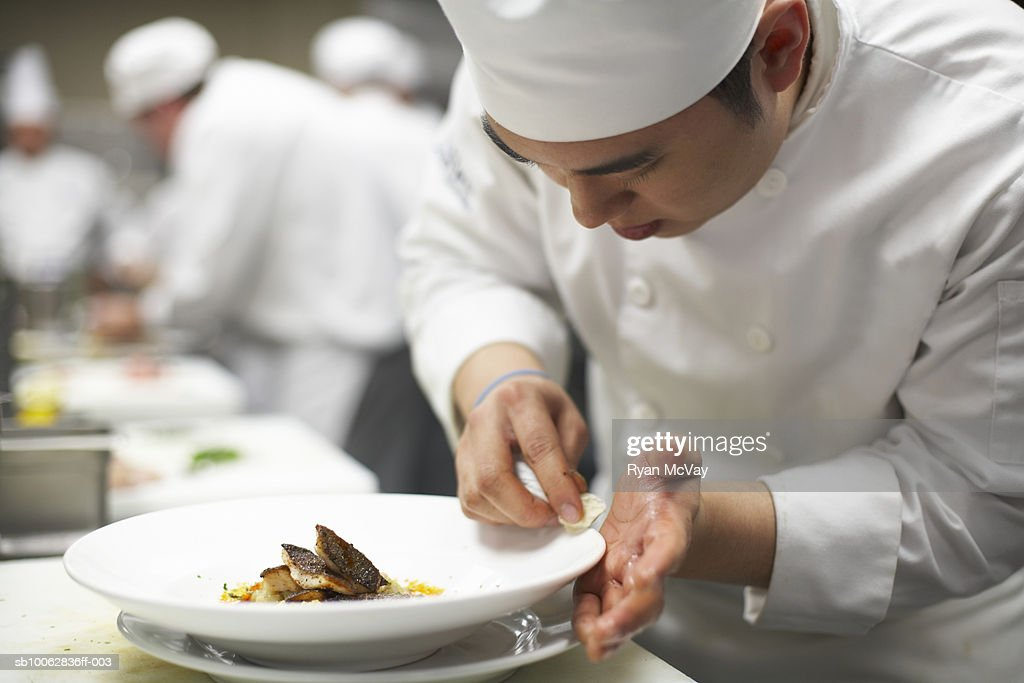 Chef preparing entree, close-up