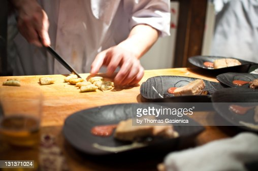 Chef preparing food in Japanese restaurant