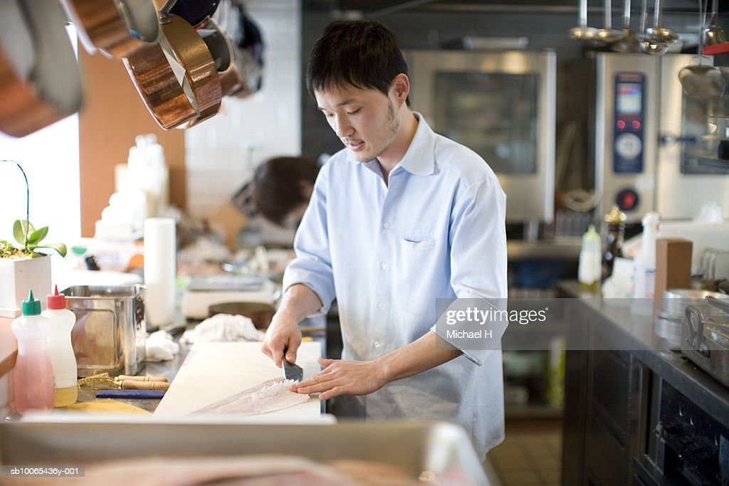 Chef preparing food in kitchen : Stock Photo