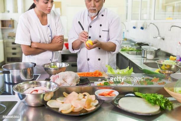 Chef preparing fruits and vegetables for salad
