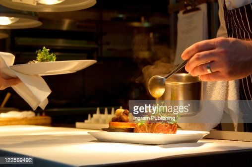 Chef putting final touches on gourmet meal. : Stock Photo