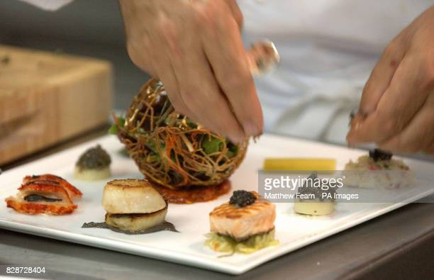 Chef Raymond Blanc puts the finishing touches to the world's most expensive salad at the Hempel Hotel in London's Bayswater The Florette Sea and...