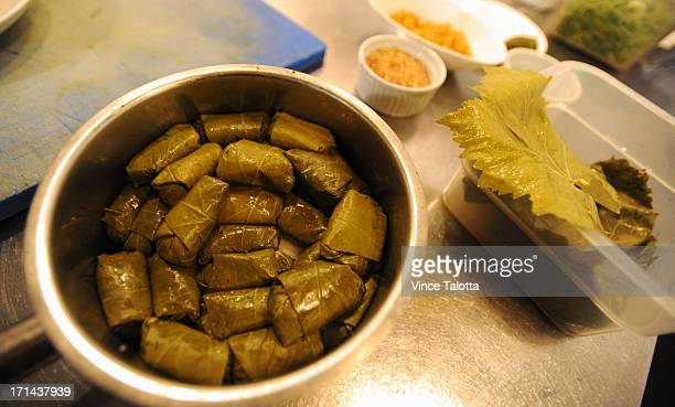 Chef Reza Parsia for Feast dolmades recipe which involves grape leaves Metaxa soaked golden raisins pine nuts dill parsleymint Arborio rice tzatkiki...