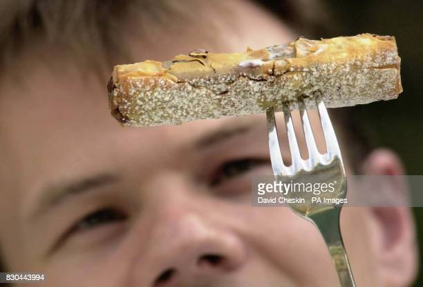 Chef Richard Glennie inspects one of Scotland's most infamous delicacies a deep fried Mars Bar which has made its way onto the dessert menu at...