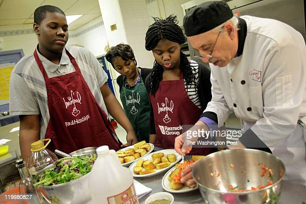 Chef Robert Barolin of City Square Cafe in Manassas shows children how to prepare bruschetta at Brainfood a nonprofit youth development organization...