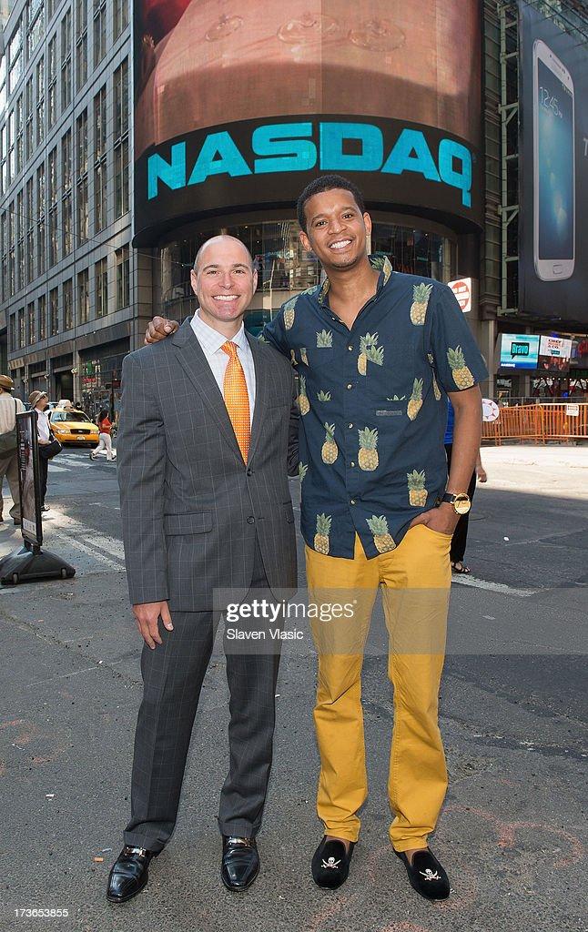 Chef Roble Ali (R) and Jay Heller of Nasdaq visit NASDAQ MarketSite on July 16, 2013 in New York City.