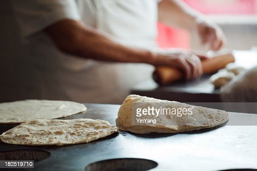 Chef Rolling, Frying Flour Tortillas in Mexican Restaurant Commercial Kitchen