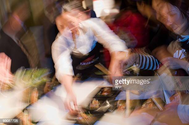A chef rushes to prepare a dish at the 'Seven Sushi Samurai' Sushi of the Year awards 2009 at the Olympia exhibition centre in west London on...