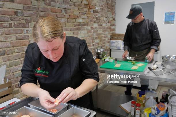Chef Sara Lawson Operations and Commercialization Chef with Applebees works with a piece of lobster at Fork Food Lab in Portland on Wednesday July 26...