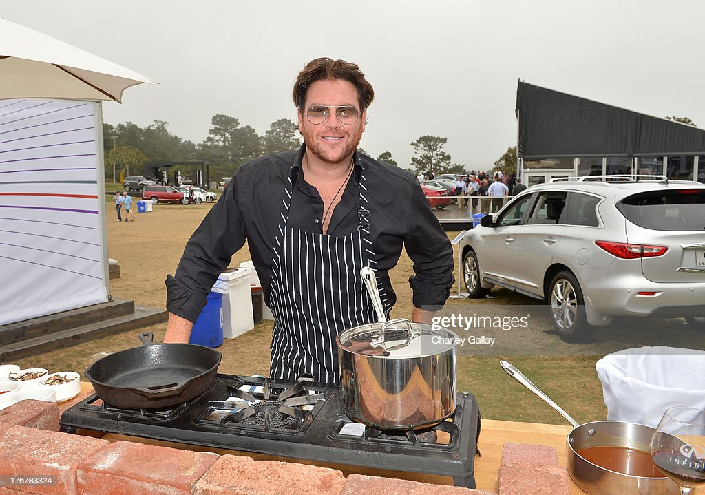 Chef Scott Conant prepares food during day 4 of Moments of Inspiration presented by Infiniti in partnership with Hearst Magazines on August 18, 2013 in Pebble Beach, California.