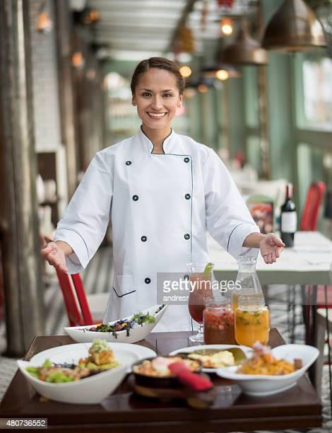 Chef serving dinner at a restaurant
