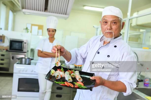 Chef serving spring rolls