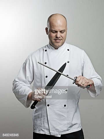 Chef sharpens his knife