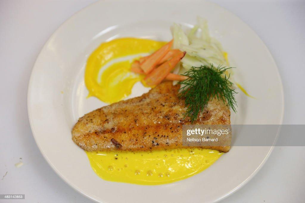 Chef Shaun Hergatt of Juni prepares Yellow Fin Tuna Hijiki Seaweed and Cucumber Gelee Flounder Saffron Esupma Kingfish Blood Orange and Pommes Puree...